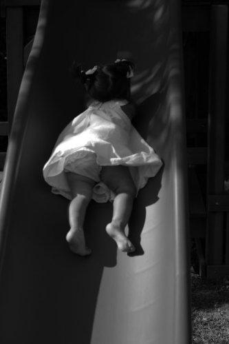 Girl_playing_on_slide_image